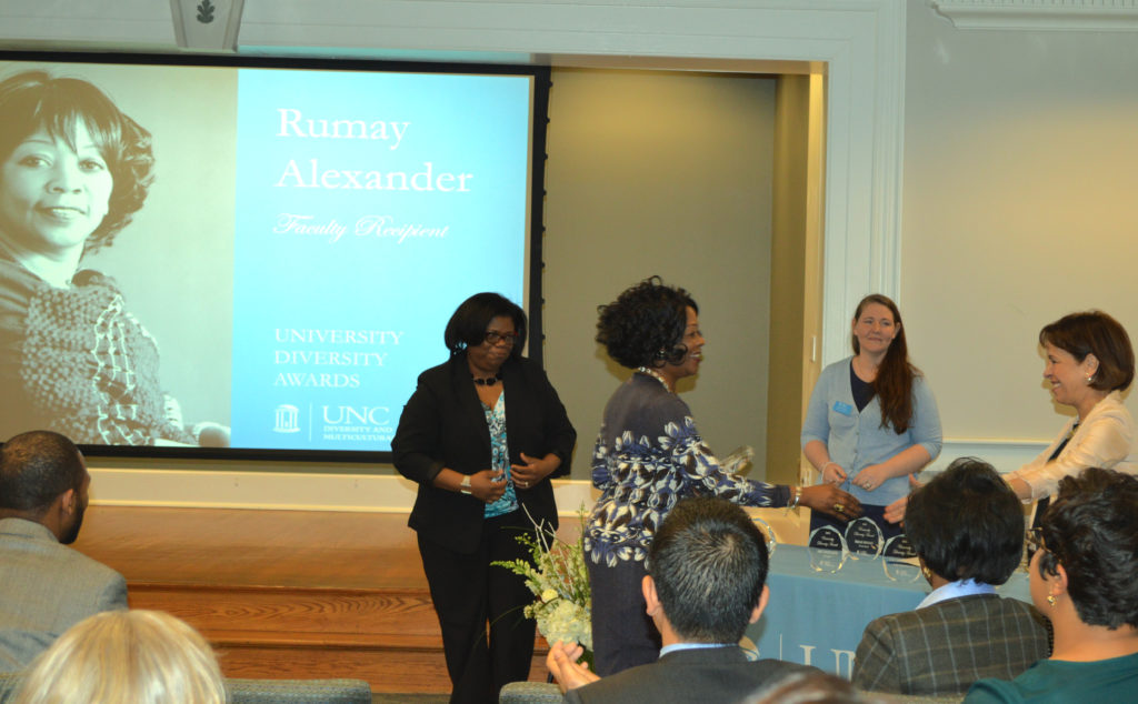 Dr. Alexander receives the Faculty Diversity Award from Chancellor Folt.