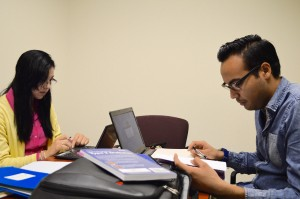 Beatriz and Eduardo at work on a literature review for Dr. Diane Berry.