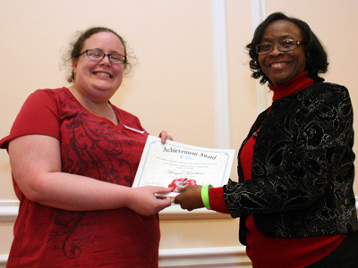 Lead Staff Representative Lee Smith with Extra Mile award recipient Megan Goodwin.
