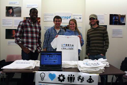 From left to right: Andrew Amolegbe, Jesse Goldberg, McKenzie Jenkins, and Jedediah Hinkley helped launch the Tar Heel Wellness Campaign by giving away t-shirts in the Student Union.