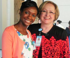 Tamryn Fowler Gray (left) received the UNC Hospitals Faculty Award from UNC Hospitals senior vice president and chief nursing officer Dr. Mary Tonges (right) as well as Dr. Cathy Madigan, vice president of nursing and associate chief nursing officer; and the Nursing Staff Recognition Week Committee.