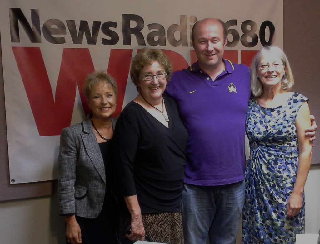 Jean Sellers and Deborah Mayer with radio co-host Dave Richmond, host Mary Lawrence.
