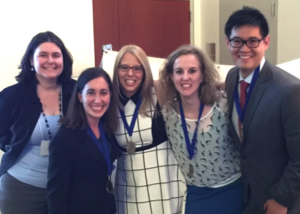 The team's student members pose with faculty advisor Kelly Scolaro (left).